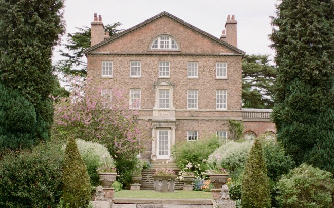 Manor house in english country garden